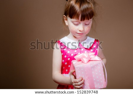girl with red hair with gifts