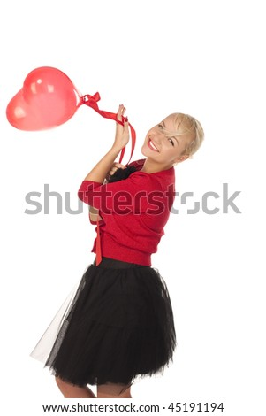 girl with red heart balloon over white