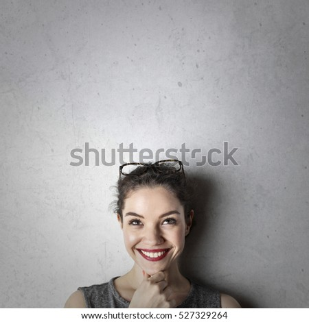 Girl with red lipstick and wide smile