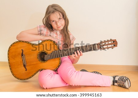 Girl with Russian seven-string acoustic guitar