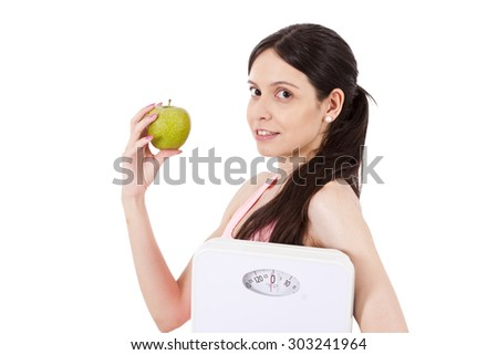 Girl with scales and apple - stock photo