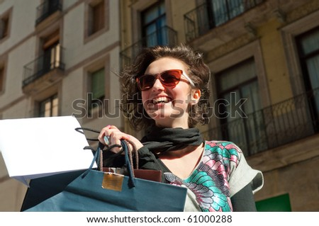 Girl with shopping bags in the city - stock photo