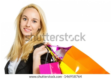 Girl with shopping bags isolated on white background