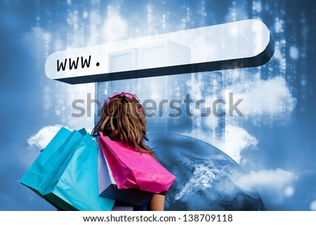 Girl with shopping bags looking at address bar with data servers on top of earth - stock photo