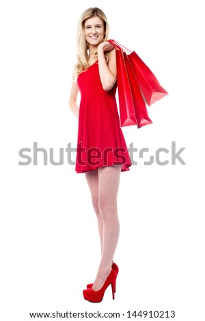 Girl with shopping bags slung over her shoulder