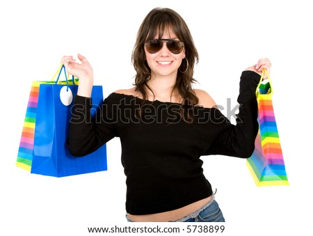girl with shopping bags smiling - isolated over a white background