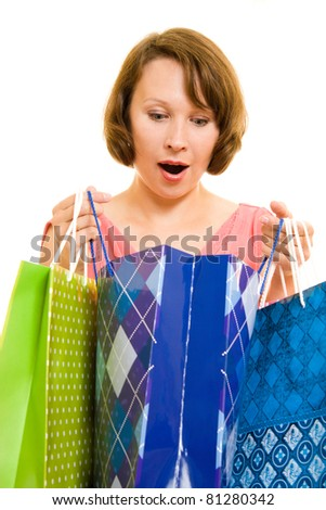 Girl with shopping on white background.