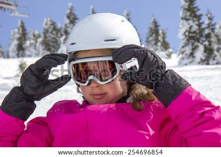 Girl with ski goggles - stock photo