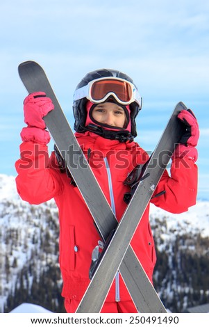 Girl with ski on the snow