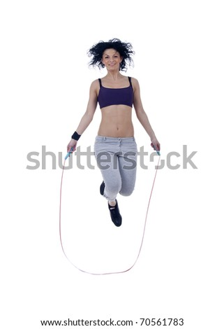 girl with skipping rope,  hair flying, isolated on white - stock photo