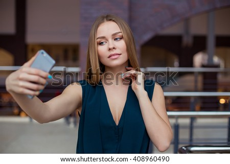 Girl with smartphone in office - stock photo