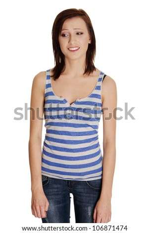 Girl with smiling, uncertain face. Jeans and striped T-shirt. Isolated on the white background.