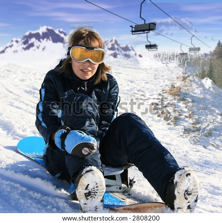 girl with snowboard over the mountain background - stock photo