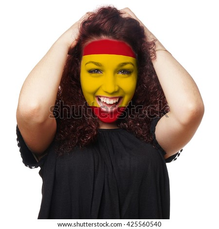 girl with spanish flag face paint. female soccer fan from spain - stock photo