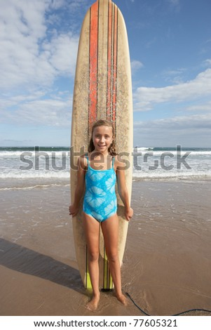 Girl with surfboard - stock photo