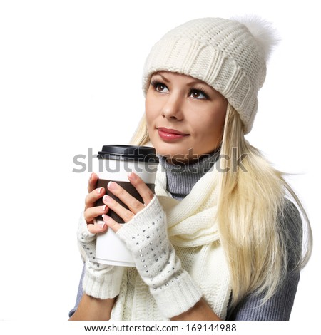 Girl with Takeaway Coffee Cup isolated on white. Blonde Beautiful Young Woman in Knitted Hat and Scarf. Portrait - stock photo