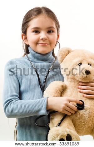 Girl with teddy and stethoscope