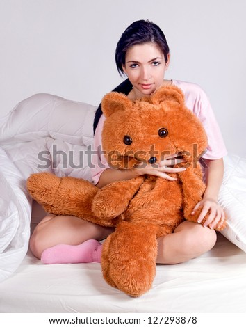 girl with teddy bear in bed