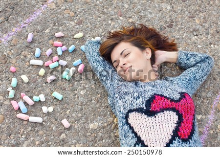Girl with the chalks relaxing  - stock photo