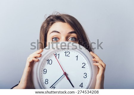 girl with the clock - stock photo