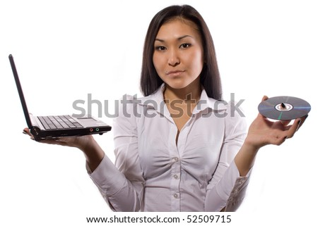 girl with the laptop and CD disk - stock photo