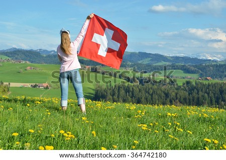 Girl with the Swiss flag. Emmental, Switzerland - stock photo