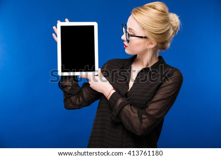 girl with the tablet on a blue background