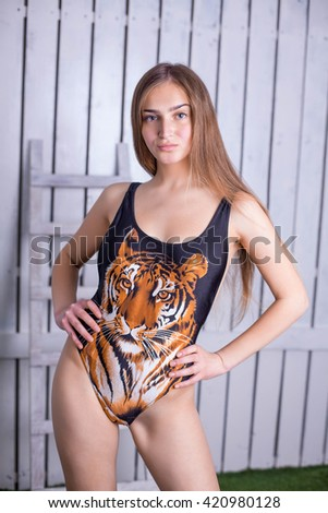 Girl with the tiger  - stock photo