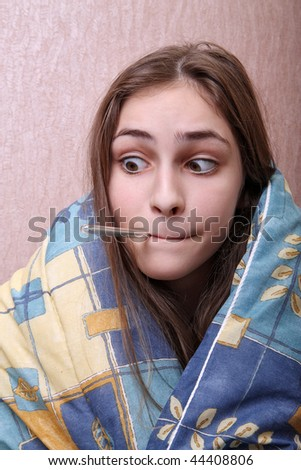 girl with thermometer in her mouth - stock photo