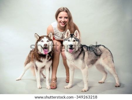 Girl with two dogs Siberian husky