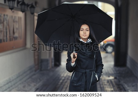 Girl with umbrella - stock photo