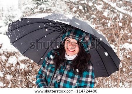 Girl with umbrella in the snow closeup - stock photo