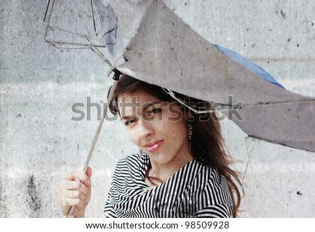 girl with umbrella. Photo in old color image style - stock photo