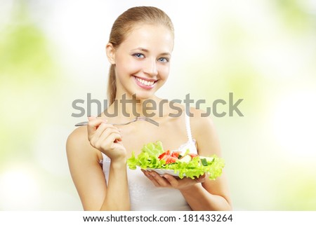 girl with vegetable salad on a light background