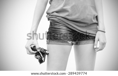 girl with vintage camera black and white - stock photo