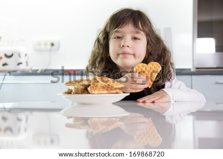 Girl with waffles - stock photo