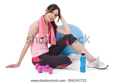Girl with water, ball and dumbbells