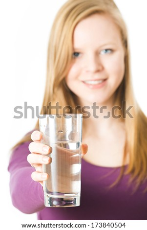 Girl with water glass isolated on white