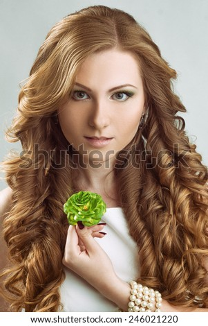 Girl with wedding hairstyle and flower - stock photo