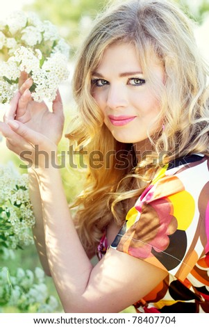 Girl with white flowers - stock photo