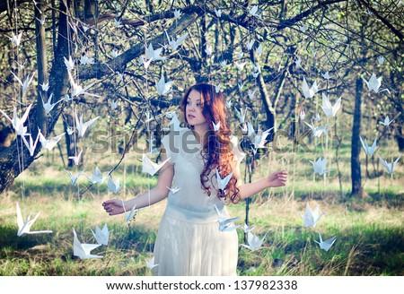 Girl with white origami cranes - stock photo