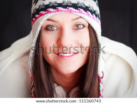 Girl with winter cap.Beautiful smiling girl with winter cap