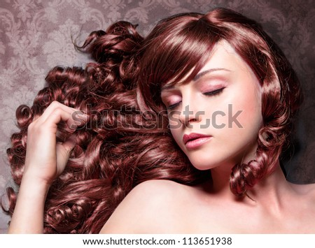 girl with wonderful red curly and shiny hair - stock photo