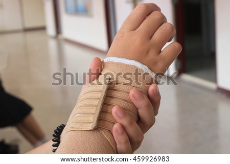 girl with wrist pain in an Elastic Bandage