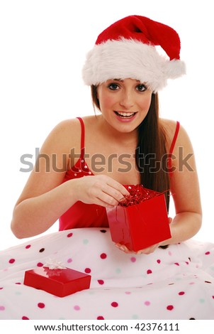 Girl with xmas gift in bed on white background - stock photo