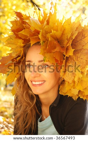 Girl with yellow autumn leaves