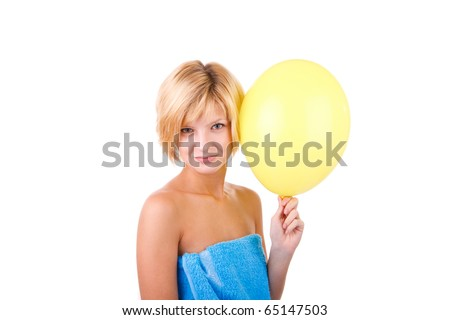 Girl with yellow balloon in blue towel