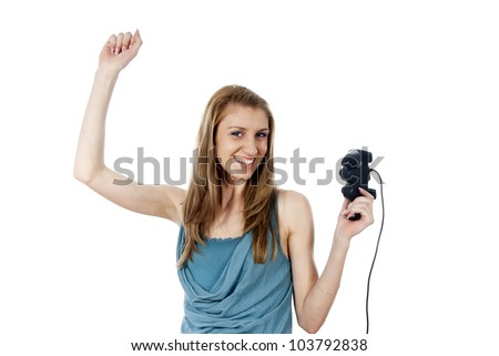 Girl won the game joysticks - stock photo