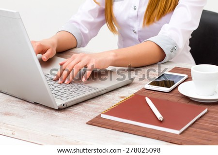 Girl working at the computer in the office. Hands close-up girl.  - stock photo
