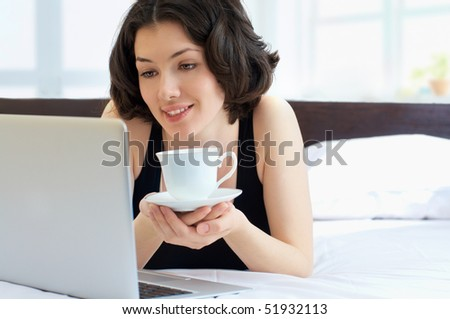Girl working on computer in light room